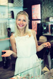 Girl customer in bijouterie shop Stock Photography