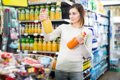 Girl customer looking for refreshing beverages royalty free stock photo
