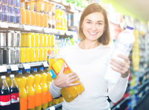 Girl customer looking for refreshing beverages Royalty Free Stock Image