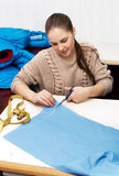 Girl cut blue cloth Royalty Free Stock Images