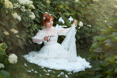 Girl cut dress. The girl in a wedding dress cut it recasting style royalty free stock photography