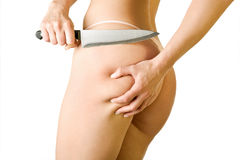 Girl cut off her cellulite, isolated on white Royalty Free Stock Photography