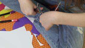 Girl cut out with scissors self-made doll. Girl cut out with scissors self-made colorful paper doll stock footage