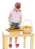 Girl cut salad Royalty Free Stock Photo