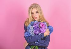 Girl cute blonde hug hydrangea flowers bouquet. Natural beauty concept. Skin care and beauty treatment. Gentle delicate royalty free stock image