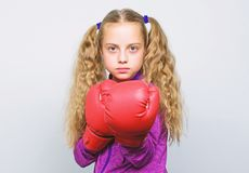 Girl cute child with red gloves posing on white background. Cute kid with sport boxing gloves. Boxing sport for female stock photo