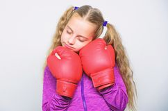 Girl cute child with red gloves posing on white background. Sport upbringing. Upbringing for leader. Strong child boxing royalty free stock photo