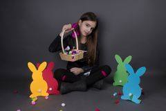 Girl cute happiness easter isolated on silver. Paper bunnies eggs Royalty Free Stock Photo