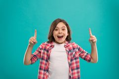 Girl cute surprised face found out important idea. Little girl long hair got bright idea. Little child smile excited. With new idea stand over blue background royalty free stock image