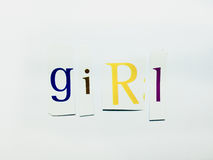 Girl - Cutout Words Collage Of Mixed Magazine Letters with White Background. Caption composed with letters torn from magazines with White Background Royalty Free Stock Image