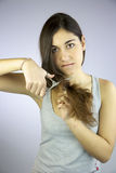 Girl cuts all her long hair unhappy of it Royalty Free Stock Photos