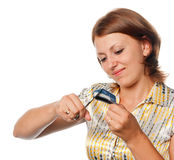 Girl cuts a credit card, refusal of crediting Royalty Free Stock Image