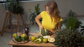 Girl Cuts Fresh Broccoli stock video footage
