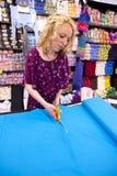 Girl cutting fabric 2 Royalty Free Stock Photos