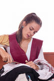 Girl cutting fabric and clothes with scissors Royalty Free Stock Photography