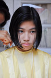 Girl is cutting hair Royalty Free Stock Photo