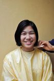 Girl is cutting hair Stock Photo