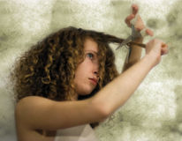Girl cutting hair Stock Photo