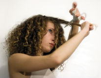 Girl cutting hair Stock Images