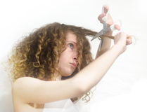 Girl cutting hair Stock Photo