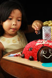 The girl cutting her birthday cake. Royalty Free Stock Photos
