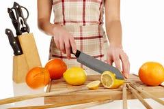 Girl cutting lemon in slices 2 Stock Photo
