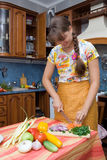 Girl Cutting Onion Royalty Free Stock Photos