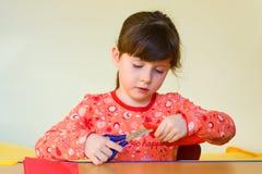 Girl cutting paper Stock Photos