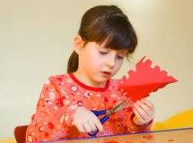 Girl cutting paper Royalty Free Stock Images