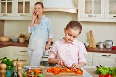 Girl cutting pepper Stock Photography