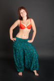 Girl in a cyan Indian trousers Stock Image