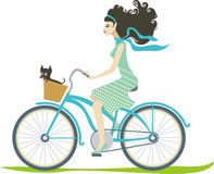 Girl cycling. Beautiful girl riding cruiser bike with her little dog Stock Image