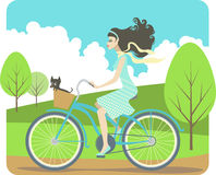 Girl cycling. Beautiful girl riding cruiser bike with her little dog Royalty Free Stock Photos