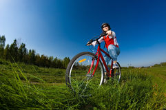 Girl cycling Royalty Free Stock Image