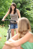 Girl cycling in park Royalty Free Stock Image
