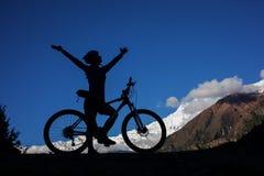 Girl cycling at the road stock photos