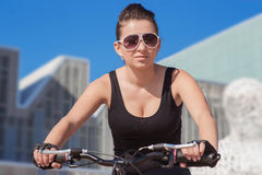 Girl cycling in urban environments Stock Image
