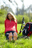 Girl cyclist barefoot enjoying relaxation Stock Image