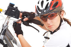 Girl Cyclist repair her bike Stock Photo
