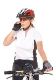 Girl Cyclist talking on the phone Royalty Free Stock Image