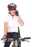 Girl Cyclist talking on the phone Stock Images