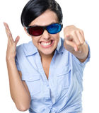 Girl in 3D glasses touching the imaginary screen Royalty Free Stock Images