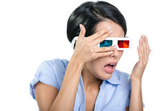 Girl in 3D glasses watches film through hands Royalty Free Stock Photo