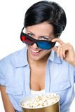 Girl in 3D glasses watching film with popcorn Royalty Free Stock Photography