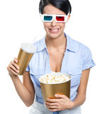 Girl in 3D spectacles with beverage and popcorn Royalty Free Stock Photos