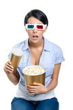 Girl in 3D spectacles with drink and popcorn Royalty Free Stock Image