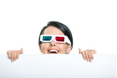 Girl in 3D spectacles peeps out Royalty Free Stock Images