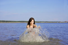 Girl dabble in the sea Royalty Free Stock Photos