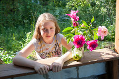 Girl at the dacha with a bouquet of flowers Royalty Free Stock Photos