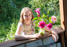Girl at the dacha with a bouquet of flowers Royalty Free Stock Photo